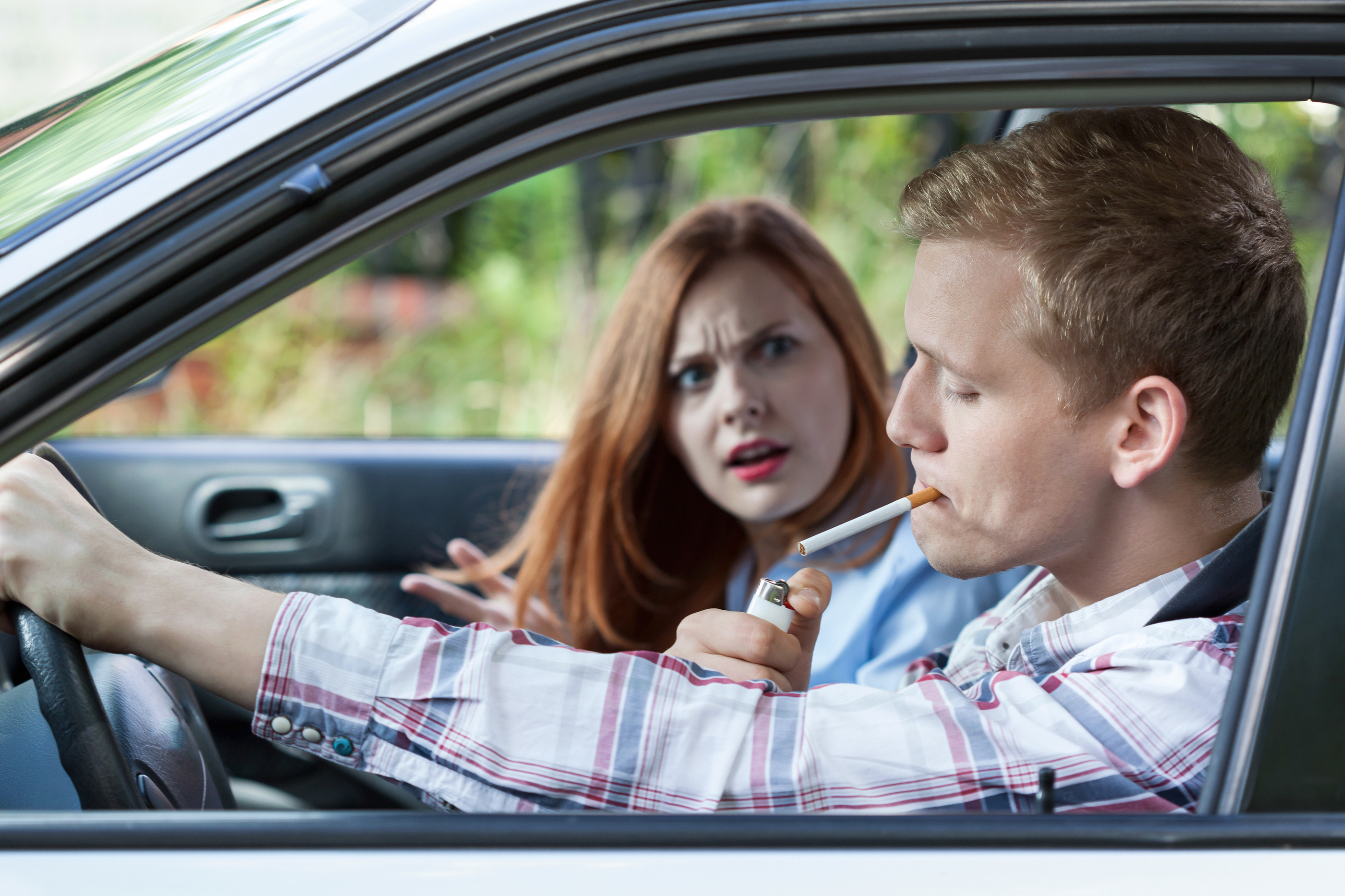 bigstock-couple-argue-over-car-smoking-76679582.jpg