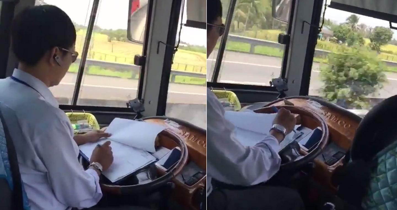 Video: Tài xế tranh thủ ghi chép khi đang lái xe