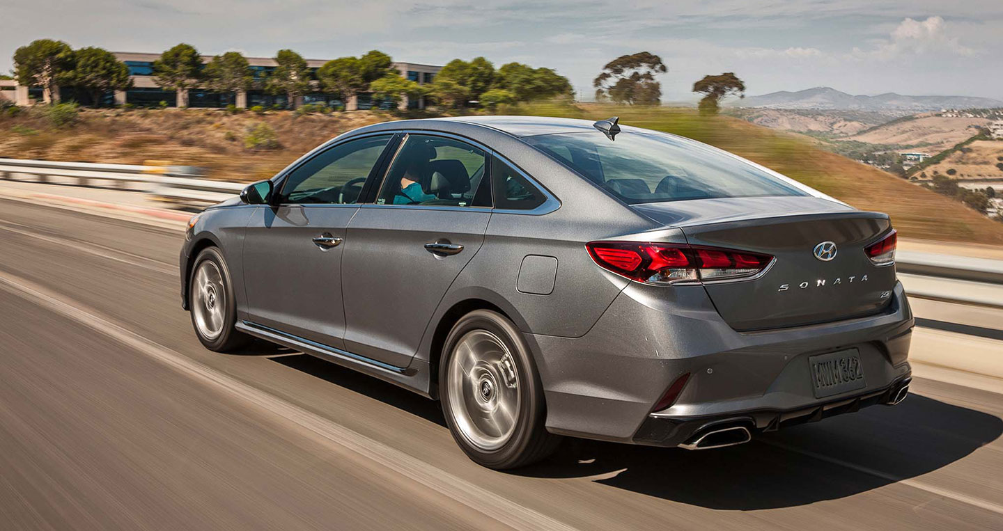 2018-hyundai-sonata-20t-limited-rear-three-quarter-in-motion-04.jpg