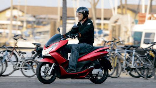 Honda giới thiệu PCX 2013 tiết kiệm nhiên liệu hơn - 1